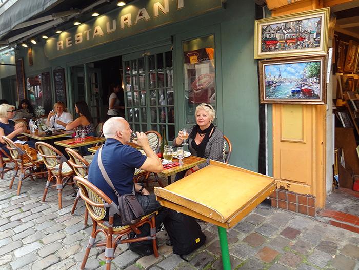 couple at a café in Paris seen during walks in Paris