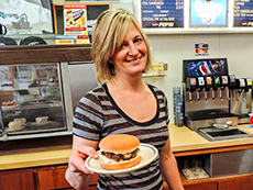 woman serving a hamburger at Hudson's Hamburgers, Coeur d'Alene among my memorable travel experiences