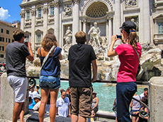 Tourists at Trevi Fountain, Rome, Italy, one of the Top Free Things To Do in Europe