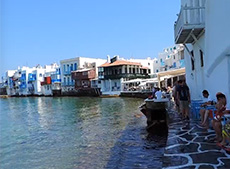 People having drinks on Little Venice on Mykonos among my memorable travel experiences