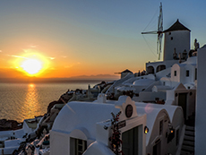 Sunset in Oia by a windmill