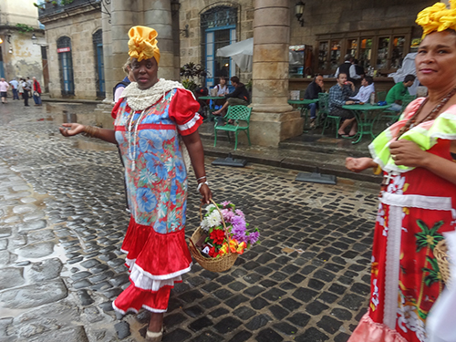 Cuban women in traditional brightly colored dress