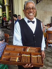 man selling cigars in Havana