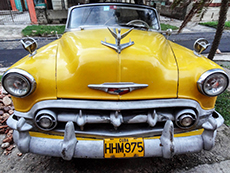an old American yellow car in Havana