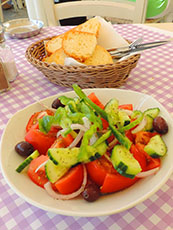 salad and bread on table at restaurant