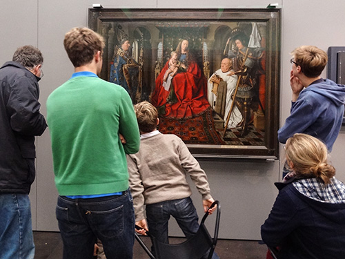 family looking at a painting in a museum