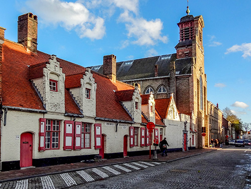 colorful old buildings on a cobblestone street in Bruges
