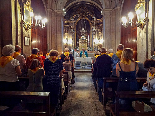 people standing at mass in a chapel in Lisbon