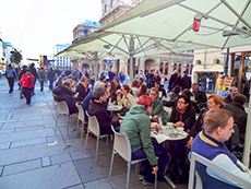 people sitting at a crowded outdoor café in Vienna