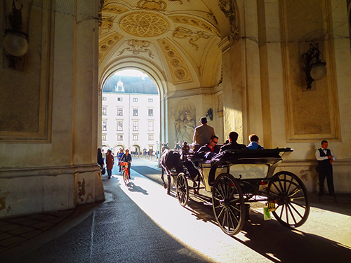 horse and carriage  going through a gate