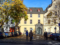 people walking on a street with old buildings in Koblenz