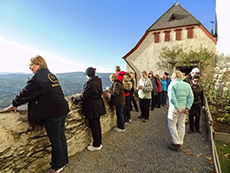 people looking across a valley from an old castle near Koblenz
