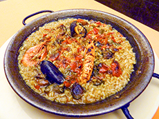 a plate of paella on a restaurant table in Barcelona