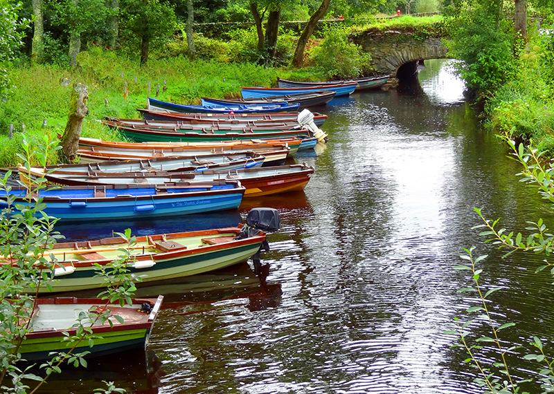boats in a stream on the Ring of Kerry in Ireland