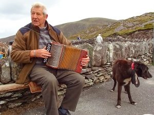 a musician and his dogon the Ring of Kerry in Ireland