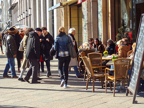 people sitting at an outdoor cafe in Berlin