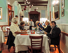 men sitting at a restaurant table in Oaxaca