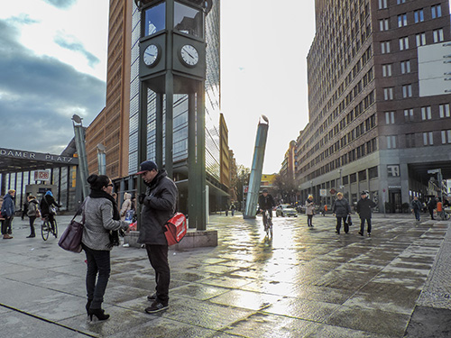 people on a city street with modern buildings in Berlin
