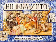 a colorful ceramic sign for a bodega