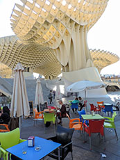 a large sulpture soaring over cafe tables