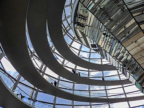 people walking on ramps inside a huge glass dome in Berlin