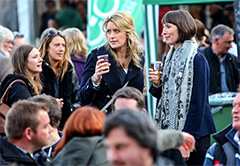 two young women drinking beer in European food festivals