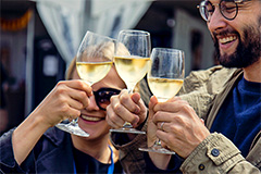 people toasting with wine in European food festivals