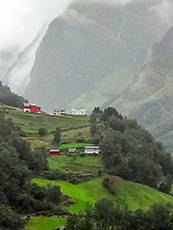 farm houses on a steep fjord hillside in Scandinavia
