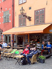people sitting in an outdoor café in Scandinavia