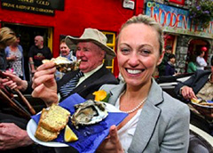 woman eating oysters in Europe