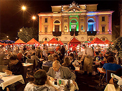 people eating at a large outdoor festival in Europe