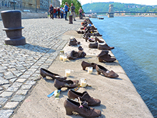 a memorial of iron shoes on a river bank in Budapest