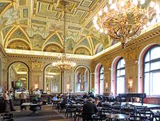 a large ornate art noveau room in Budapest