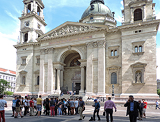 a crowd in front of a large Gothic basilica in Budapest