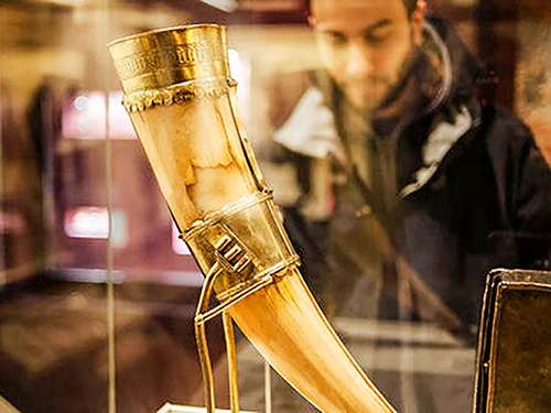 a gold encrusted hunting horn in a museum case in Dublin