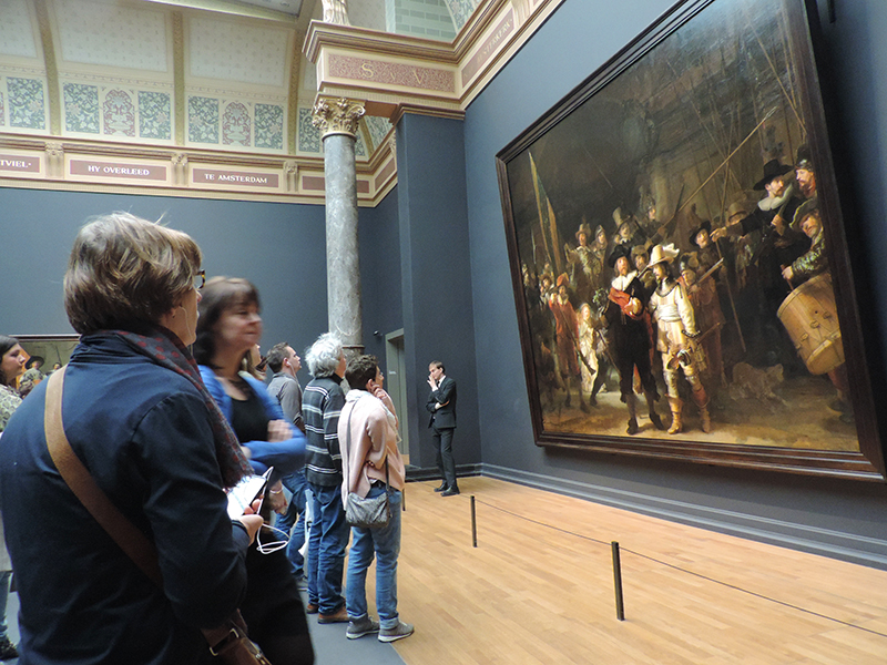 "people looking at Rembrandt's ""the Night Watch"", something to do during 48 hours in Amsterdam"