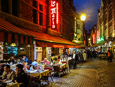 people eating at outdoor cafes at night in Europe
