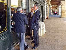 three men standing talking in Segovia