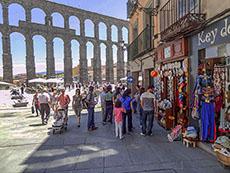 people near an old aqueduct in Segovia