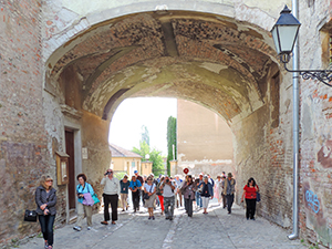 a group walking through a tunnel in an old city in Eastern Europe