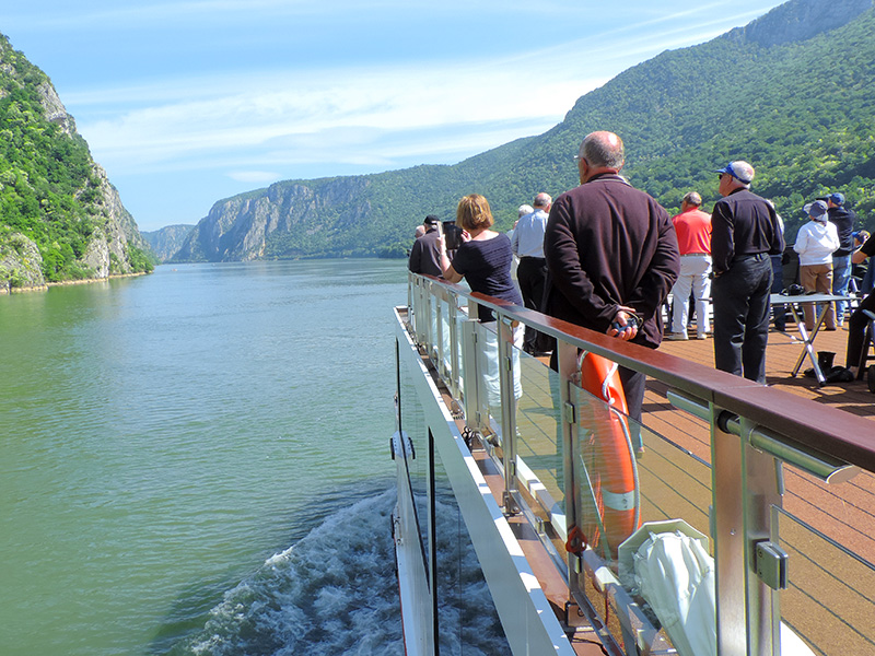 people on desck on a river cruise ship in Eastern Europe