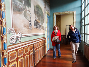 two woman looking at a mural in Cuenca