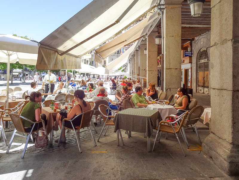 people sitting at outdoor cafes in Segovia