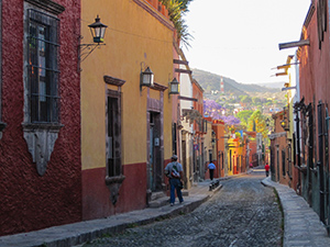 a street with colonial buildings in early morning in San Miguel de Allende