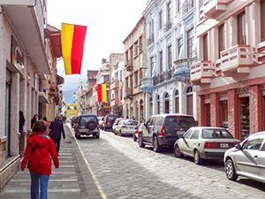 woman walking along a street in Cuenca
