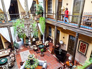 lobby of an old hotel in Cuenca