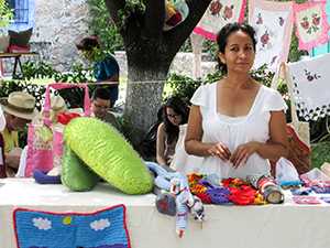 woman selling embroidery in a market in San Miguel de Allende