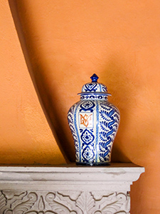 a blue vase on a shelf in San Miguel de Allende