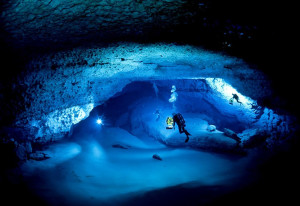 divers in an underwater cave in Florida