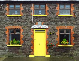 a yellow door on a house in Dingle, Ireland - Dingle Peninsula